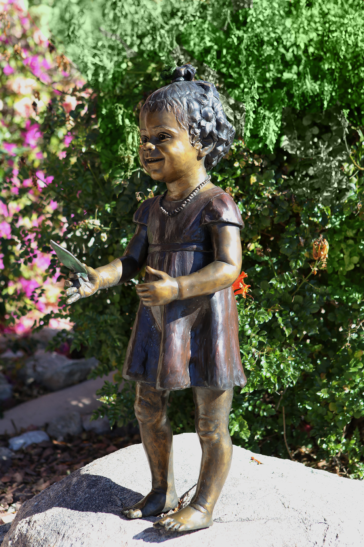Amazing Grace sculpture of a young girl, full body, left side