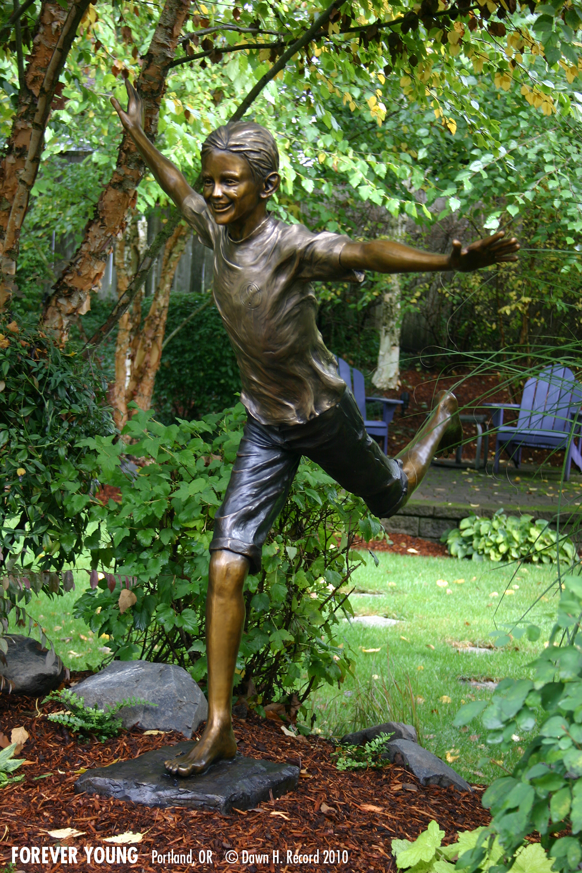 Forever young sculpture of a teen boy, left side